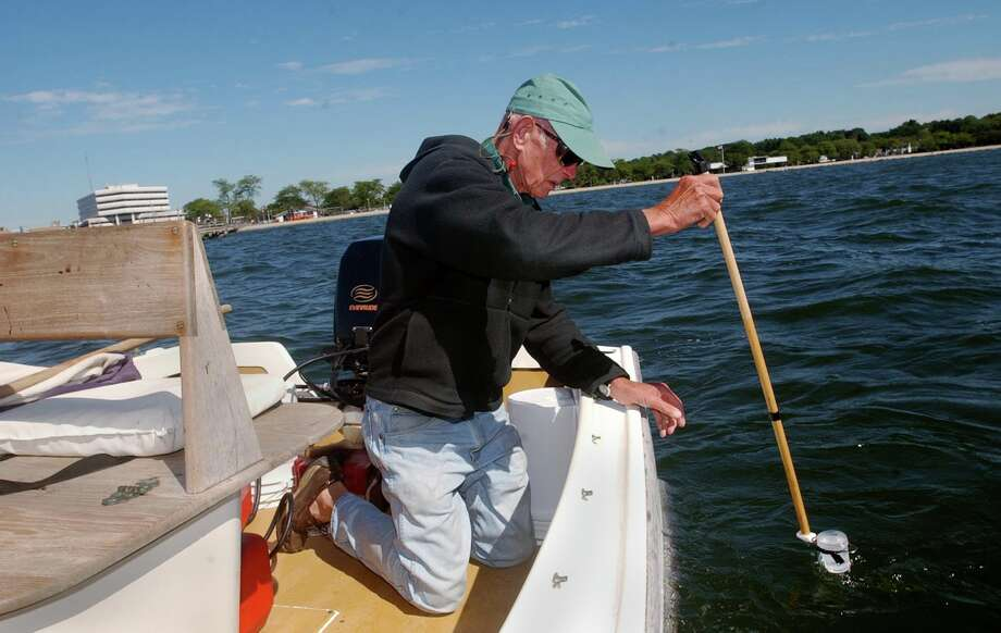Art Glowka takes a water sample in Westcott Cove in Stamford, Conn., in 2003. Glowka, a longtime Stamford resident, avid fisherman and fierce advocate for Long Island Sound, died Monday, March 25, 2013 at Stamford Hospital after a long illness. He was 82. Staff file photo Photo: Kerry Sherck, ST