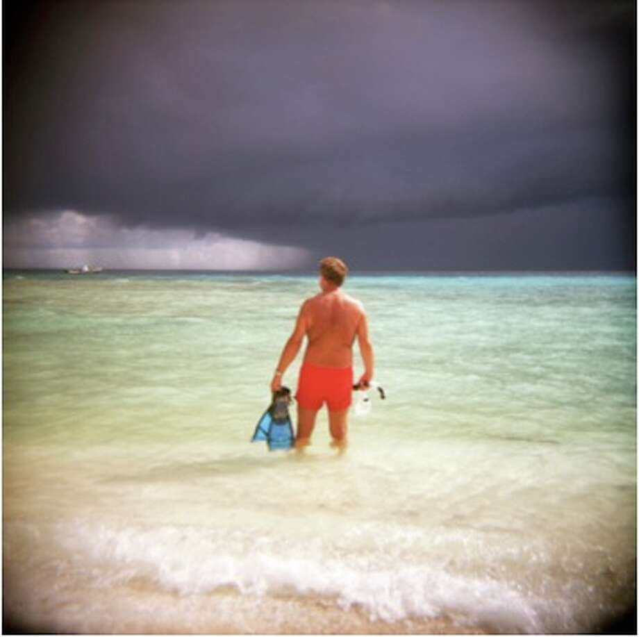 John Armstrong, Snorkler in Red Bathing Suit, 2009, photograph, 15.5x15.5