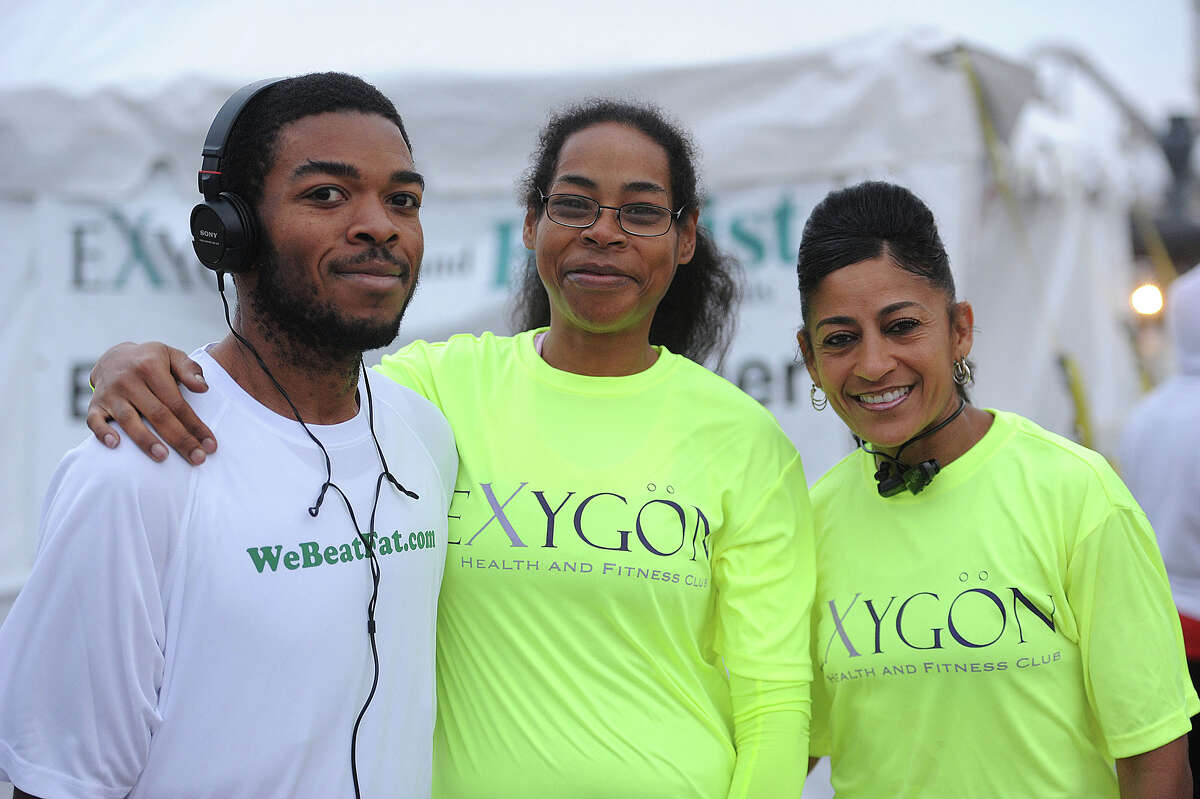 Willie Gillis, Angela Gillis and Lisha Chambers just before running the 2013 Gusher 5k. Angela said she is training to run a marathon. Photo taken March, 09, 2013 Guiseppe Barranco/The Enterprise