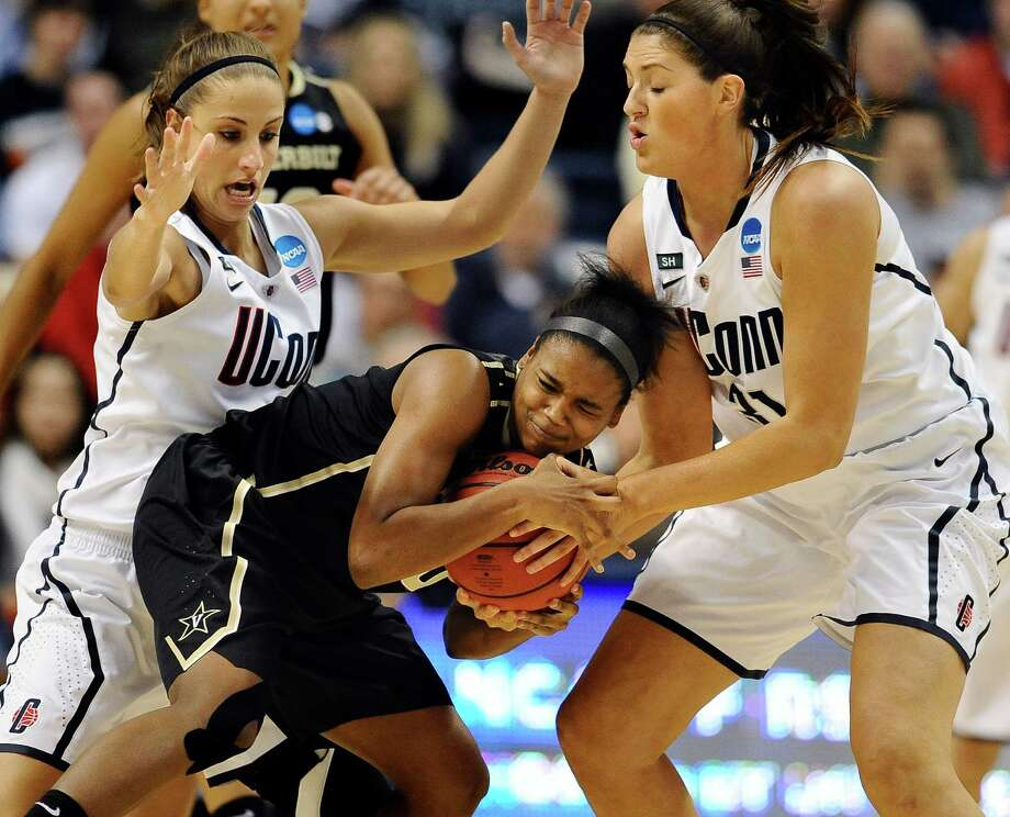 Connecticut's Caroline Doty, left, and teammate Stefanie Dolson, right, pressure Vanderbilt's Christina Foggie, center, in the first half of a second-round game in the women's NCAA college basketball tournament in Storrs, Conn., Monday, March 25, 2013. (AP Photo/Jessica Hill) Photo: Jessica Hill, Associated Press / FR125654 AP