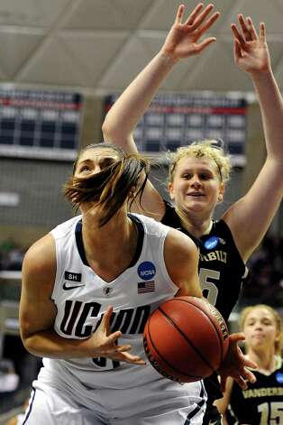 Connecticut's Stefanie Dolson, left, is guarded by Vanderbilt's Kendall Shaw, right, in the first half of a second-round game in the women's NCAA college basketball tournament in Storrs, Conn., Monday, March 25, 2013. (AP Photo/Jessica Hill) Photo: Jessica Hill, Associated Press / FR125654 AP