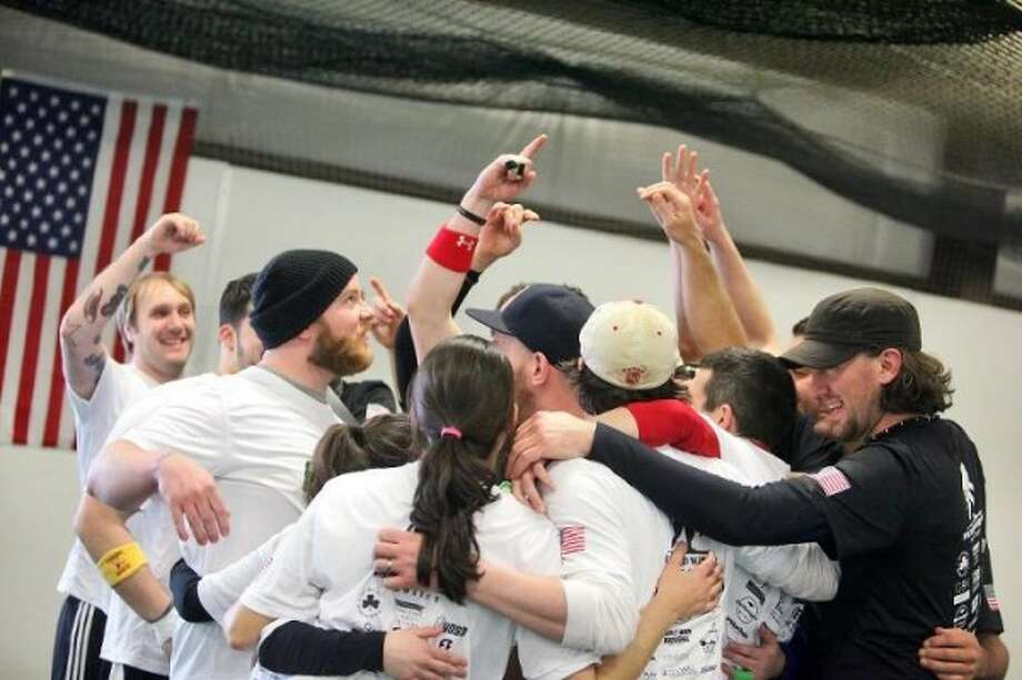 Dodgeball players celebrate over the weekend while breaking the world record for continuous play. (Erin Coker photo)