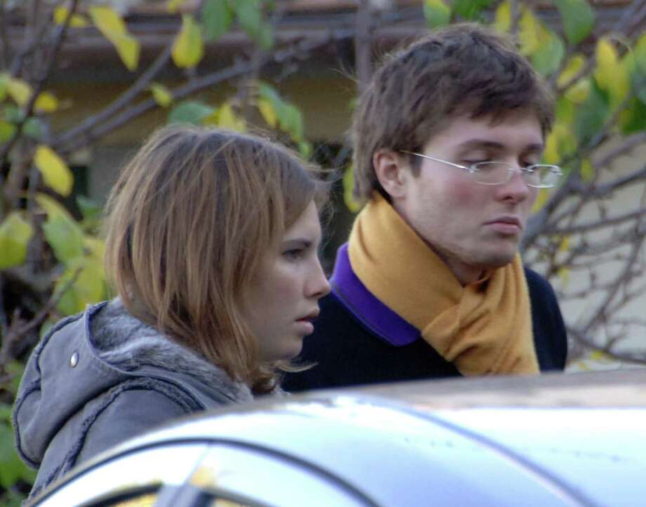 FILE - This Nov. 2, 2007 file photo shows Amanda Marie Knox, of the U.S., left, and her then-boyfriend Raffaele Sollecito, of Italy, outside the rented house where 21-year-old British student Meredith Kercher was found dead in Perugia, Italy. The Court of Cassation on Monday March 25, 2013 is considering prosecutors' contentions that the 2011 acquittals of American Knox and her Italian ex-boyfriend in the murder of British student Meredith Kercher should be thrown out and a new trial ordered. (AP Photo/Stefano Medici, File) Photo: STEFANO MEDICI
