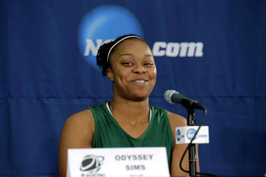 Baylor's Odyssey Sims smiles as she responds to a reporters question during a press conference at the women's NCAA college basketball tournament Monday, March 25, 2013, in Waco, Texas. Baylor is scheduled to play Florida State on Tuesday. (AP Photo/Tony Gutierrez) Photo: Tony Gutierrez, STF / AP