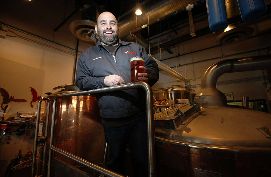 Scott Metzger, Freetail Brewing owner, watched on his office computer as the two bills were approved.