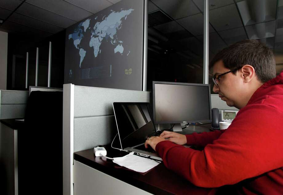 Alert Logic Senior Security Analyst Chris Dehghanpoor looks for security threats inside the company's security operations center, Monday, March 25, 2013, in Houston. The Houston-based network security company manages online threats of their Security-as-a-Service in the cloud for different entities. (Cody Duty / Houston Chronicle) Photo: Cody Duty, Staff / © 2013 Houston Chronicle
