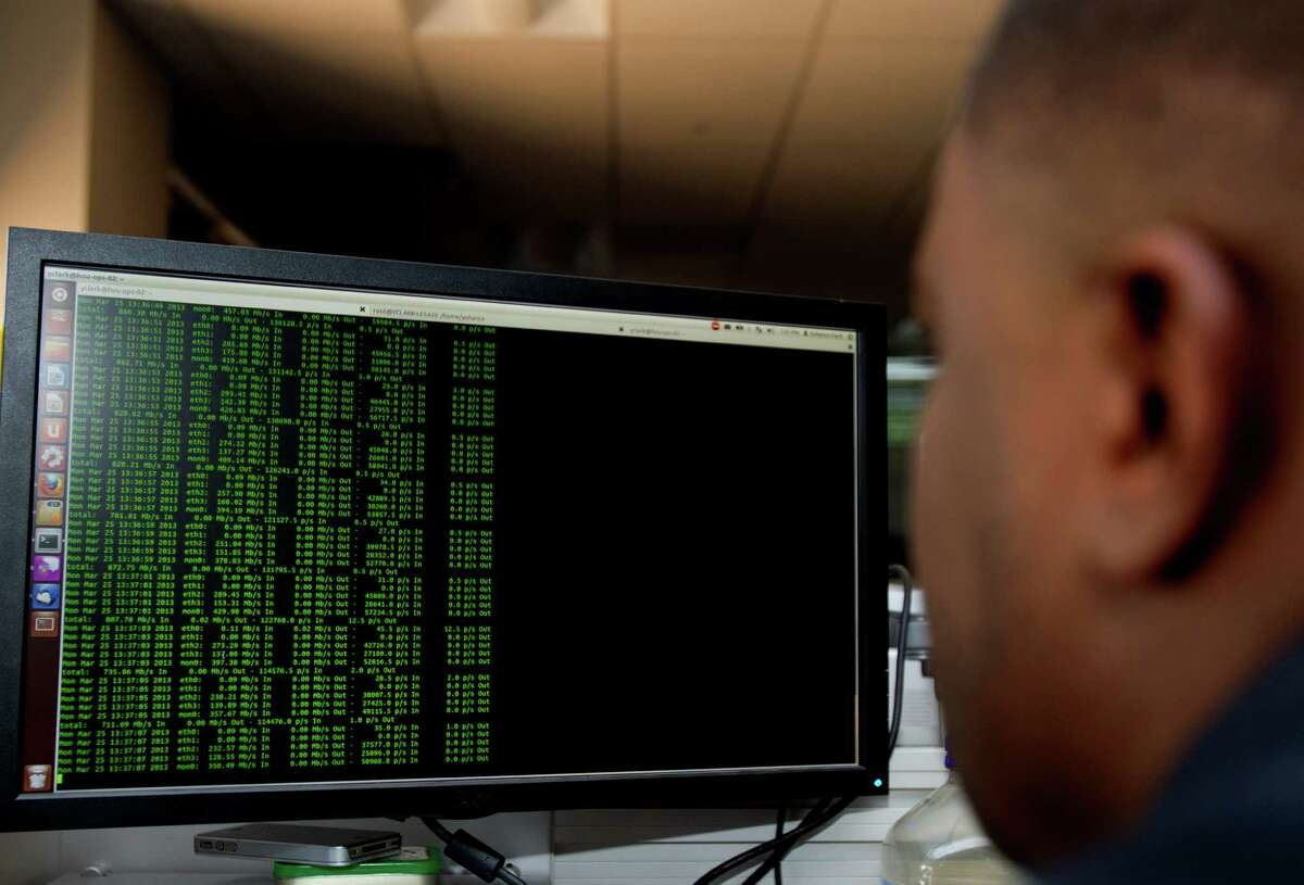 Alert Logic Network security analyst Yohance Clark looks for threats inside the company's operations center in Houston. IT security was a new entrant in a list of risks to the oil and gas industry.