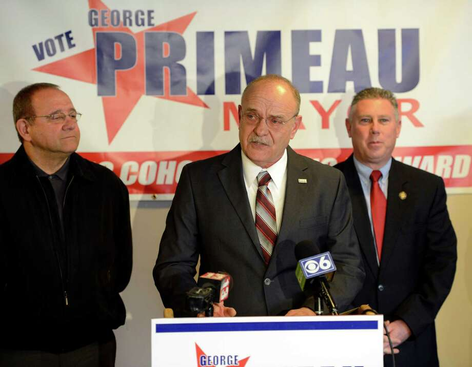 Cohoes Mayor Geroge Primeau, center,  who was appointed to the office of Mayor, makes his announcement that he is running for Mayor Monday lunchtime, March 25, 2013, in Cohoes, N.Y.  Flanking Primeau is Gil Ethier, Cohoes City Chairman and Albany County Legislator, left, and former Cohoes Mayor and now Assemblyman John McDonald. (Skip Dickstein/Times Union) Photo: SKIP DICKSTEIN / 10021655A