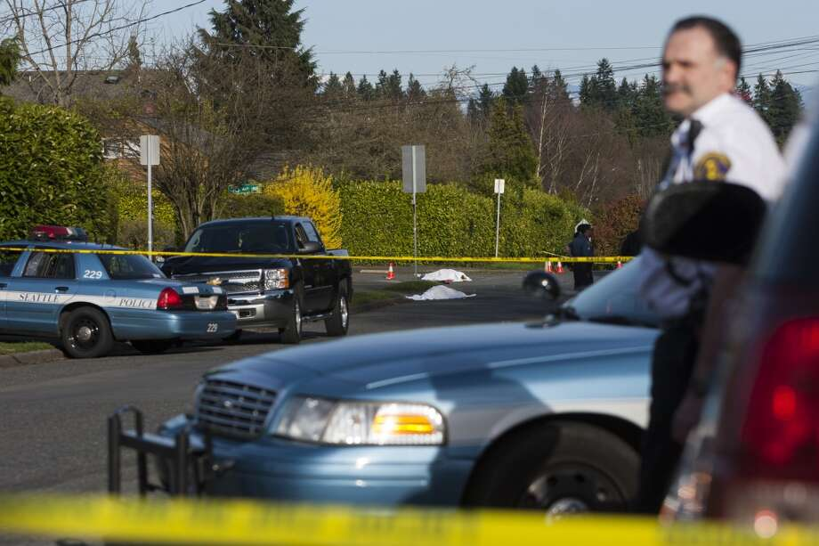 Police respond to the scene of a North Seattle car-pedestrian collision on Monday, March 25, 2013, near Nathan Eckstein Middle School in Seattle. There were four victims, including a 33-year-old woman and an infant who were rushed to Harborview Medical Center. Two other victims died on the scene. (Jordan Stead, seattlepi.com)