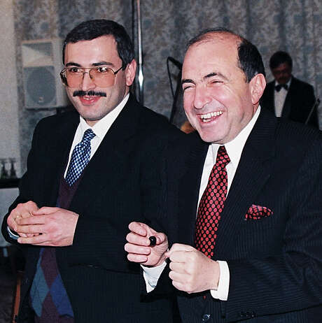 In this undated file photo, Boris Berezovsky, right, and Mikhail Khodarkovsky, two of Russia's most prominent tycoons, smile at a reception in Moscow. Photo: Alexei Kondratyev, STF / AP