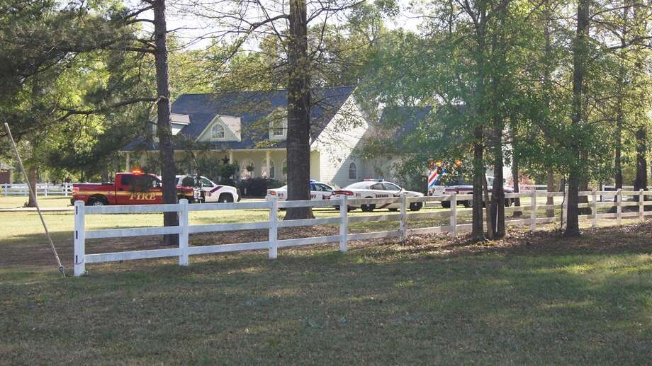 A child riding a toy tractor was found at the bottom of a pool at this home off Texas 242 in New Caney, reports say. (Scott Engle/Montgomery County Police Reporter)