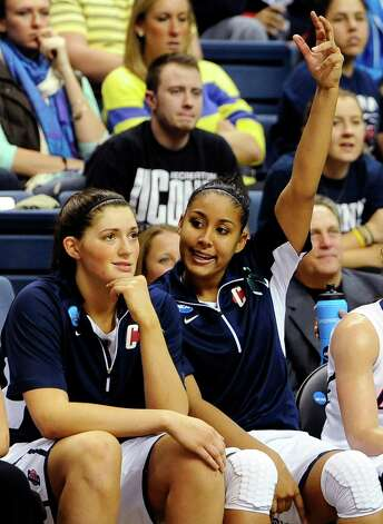 Connecticut's Kaleena Mosqueda-Lewis, right, reacts as teammate Stefanie Dolson looks on, in the final minutes the second half of a second-round game against Vanderbilt in the women's NCAA college basketball tournament in Storrs, Conn., Monday, March 25, 2013. Connecticut won 77-44. (AP Photo/Jessica Hill) Photo: Jessica Hill, Associated Press / FR125654 AP