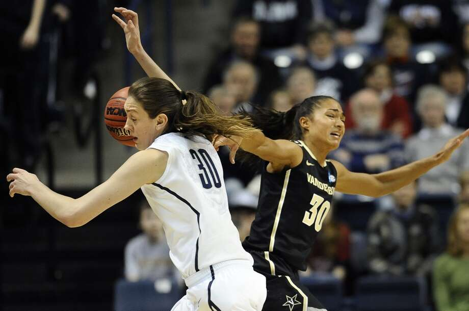 Connecticut's Breanna Stewart, left, steals the ball from Vanderbilt's Elan Brown in the first half of a second-round game in the women's NCAA college basketball tournament in Storrs, Conn., Monday, March 25, 2013. Connecticut won 77-44.(AP Photo/Jessica Hill)