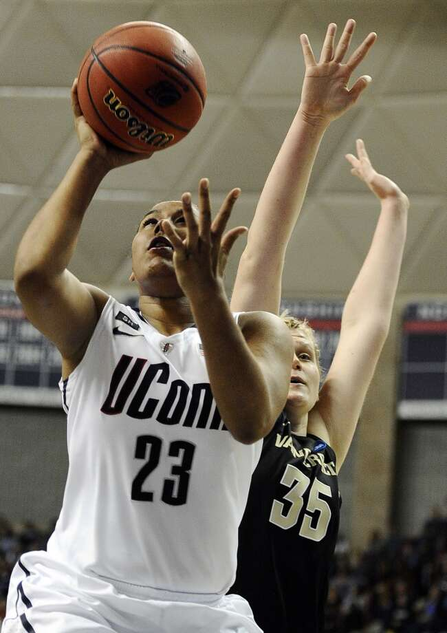 Connecticut's Kaleena Mosqueda-Lewis goes up for a basket while guarded by Vanderbilt's Kendall Shaw in the first half of a second-round game in the women's NCAA college basketball tournament in Storrs, Conn., Monday, March 25, 2013. Connecticut won 77-44. (AP Photo/Jessica Hill)