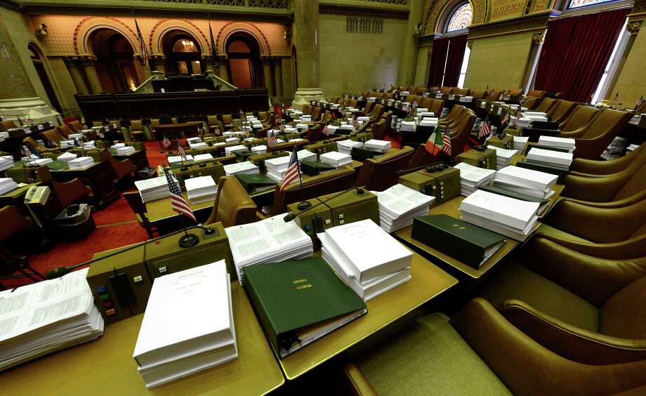 Budget manuals are stacked atop Assembly desks Monday, March 25, 2013, at the State Capitol in Albany, N.Y. Assembly returns for session on Thursday ahead of the April 1st budget deadline. (Skip Dickstein/Times Union) Photo: SKIP DICKSTEIN