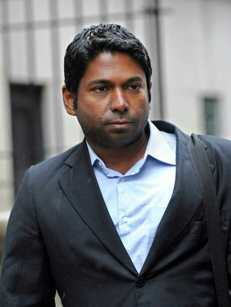 Rengan Rajaratnam  exits Manhattan federal court, Monday, March 25, 2013, in New York. The brother of jailed one-time billionaire hedge fund boss Raj Rajaratnam entered a not guilty plea to federal insider trading charges. and was released on a one million dollar bond. (AP Photo/ Louis Lanzano) Photo: Louis Lanzano, FRE / FR77522 AP