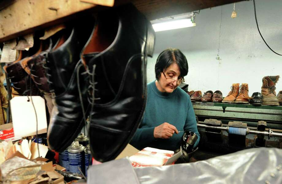 Anna Conte performs shoe repairs at Colonie Shoe Repair Thursday, March 7, 2013, in Colonie, N.Y. Anna and her husband Alberico purchased the repair shop in 1967 after the couple emigrated from Italy. Mr. Conte, who is a master cobbler, is no longer able to work at the store because of health issues. (Michael P. Farrell/Times Union) Photo: Michael  P. Farrell