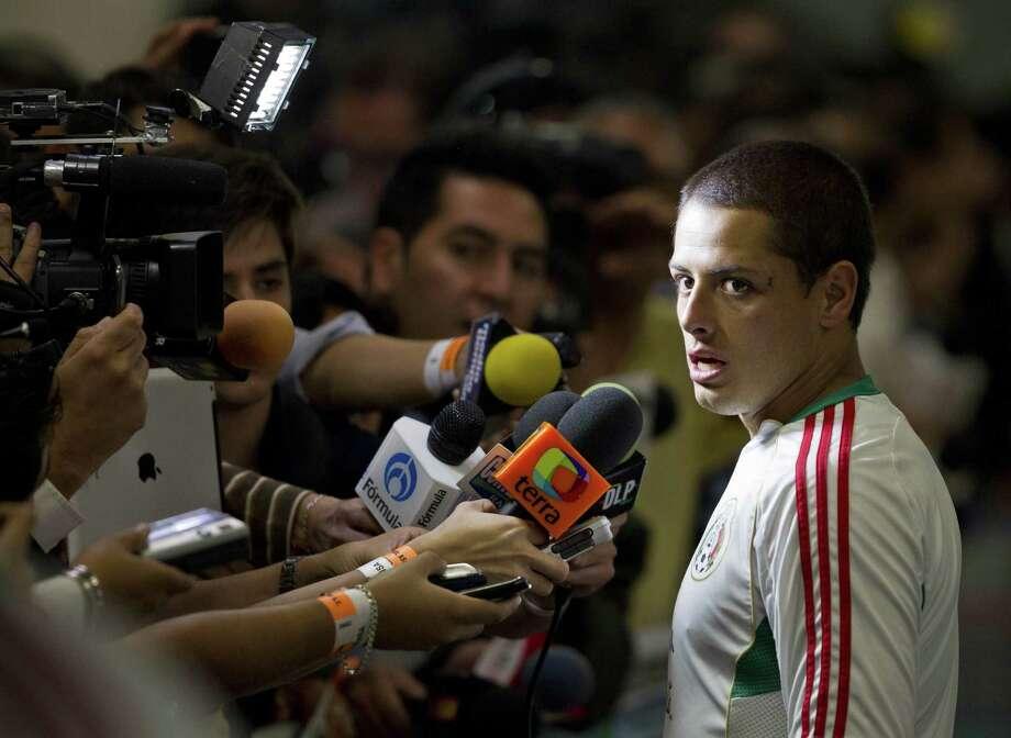 A star like Javier Hernandez can't escape the spotlight in soccer-mad Mexico. Photo: Christian Palma, STR / AP