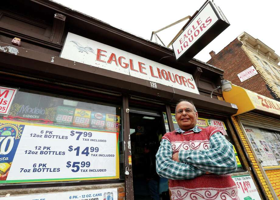 Pravin Mankodia, a seven-year employee of Eagles Liquors in Passaic, N.J., sold the winning $338 million Powerball ticket. Owner Sunil Sethi says he will use some of his $10,000 prize to fix up the store and share some with his employees. Photo: Rich Schultz, FRE / FR27227 AP