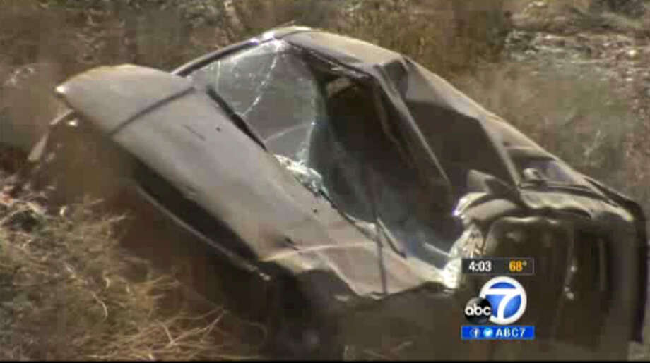 This video frame curtesy KABC TV Los Angeles shows a crash of an SUV in Action, Calif. on Sunday, March 24, 2013. A 9-year-old girl crawled out of the mangled SUV, climbed out of a canyon and walked about a mile in the middle of the night to find help after surviving the highway crash that killed her father in Southern California, authorities said. (AP Photo/KABC TV) (AP Photo/KABC TV) Photo: HONS, TEL / KABC TV