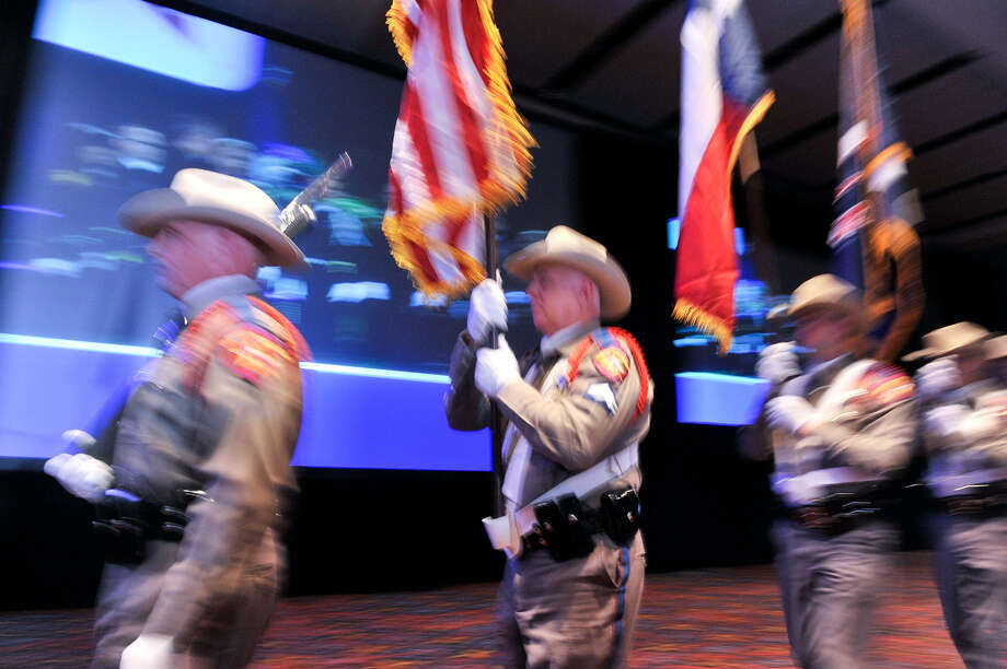 A Texas Department of Public Safety color guard takes part in the beginning of the Texas Emergency Management Conference at the Convention Center. The opening day attracted about 2,500 first responders, emergency managers and elected officials. Photo: Photos By Robin Jerstad / For The Express-News