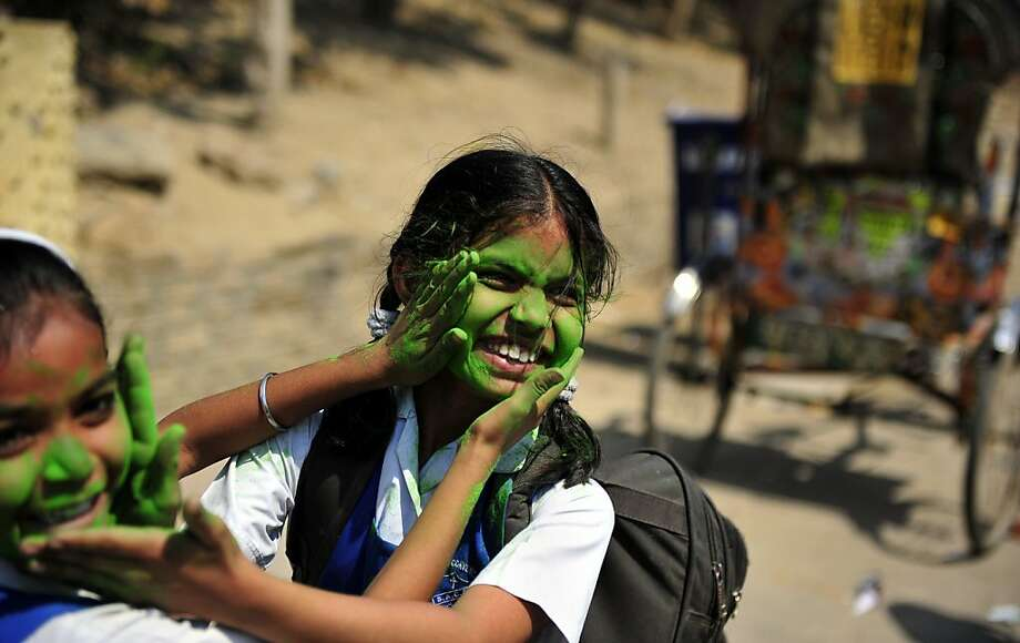 School girls play with coloured powder outside a school in Allahabad on March 25, 2013.  Holi, the popular Hindu spring festival of colours observed in India at the end of the winter season on the last full moon of the lunar month, will be celebrated March 27 this year. Sanjay Kanojia/AFP/Getty Images Photo: Sanjay Kanojia, AFP/Getty Images