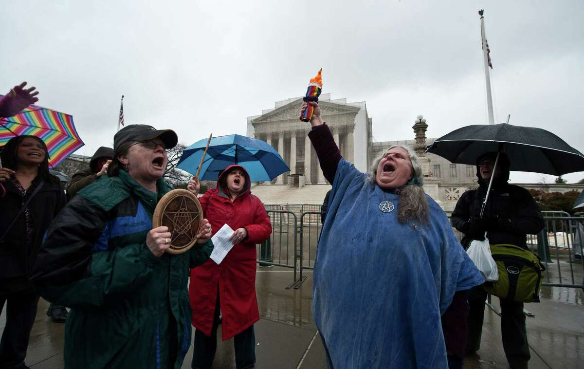 Selena Fox (second from the right) of the Circle Sanctuary Wiccan church and followers sing in favor of same-sex marriage in front of the US Supreme Court in Washington on March 25, 2013. The justices will hear arguments on March 26 on California's Proposition 8 ban on same-sex marriage and on March 27 on the federal Defense of Marriage Act, which defines marriage as between one man and one woman.