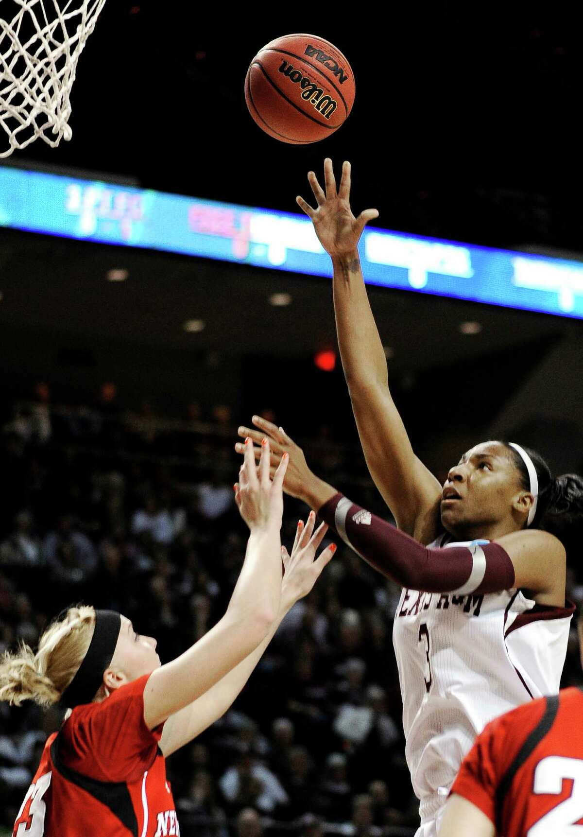 Texas A&M's Kelsey Bone (3) shoots over Nebraska's Emily Cady (23) during a second-round game in the NCAA women's college basketball tournament in College Station, Texas, Monday, March 25, 2013.