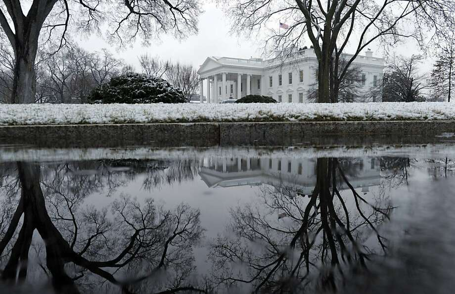 A spring snowstorm covers the North Lawn of the White House in Washington, Monday, March 25, 2013. (AP Photo/Susan Walsh) Photo: Susan Walsh, Associated Press