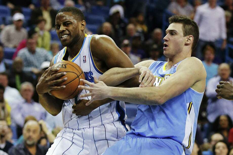 Hornets forward Darius Miller (left) and Nuggets forward Danilo Gallinari battle for a rebound in the second half of New Orleans' win Monday night. Photo: Bill Haber / Associated Press