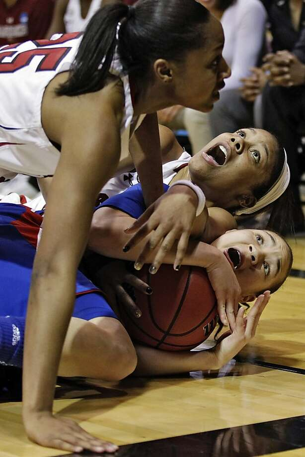 South Carolina guard Tiffany Mitchell (25), forward Ashley Bruner, center, and Kansas guard Angel Goodrich, bottom, fight for possession of the basketball during the second half of a second-round game in the women's NCAA college basketball tournament, Monday, March 25, 2013, in Boulder, Colo. (AP Photo/Ed Andrieski ) Photo: Ed Andrieski, Associated Press