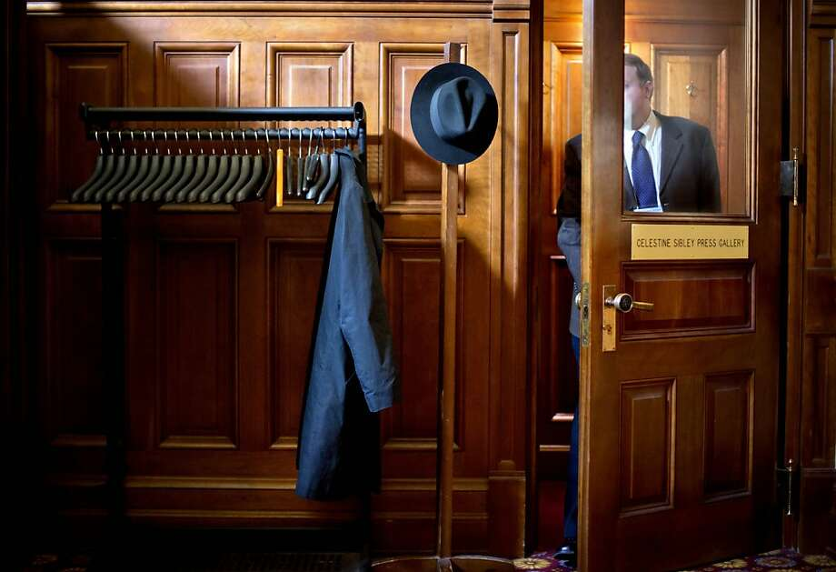 A hat and coat hang outside the Georgia House press gallery as a reporter steps out on one of the final days of this year's legislative session, Monday, March 25, 2013, in Atlanta. Lawmakers are nearing the finish line of this year's legislative session but several key issues remain including the fiscal budget, changes to gun regulations and ethics reform. (AP Photo/David Goldman) Photo: David Goldman, Associated Press
