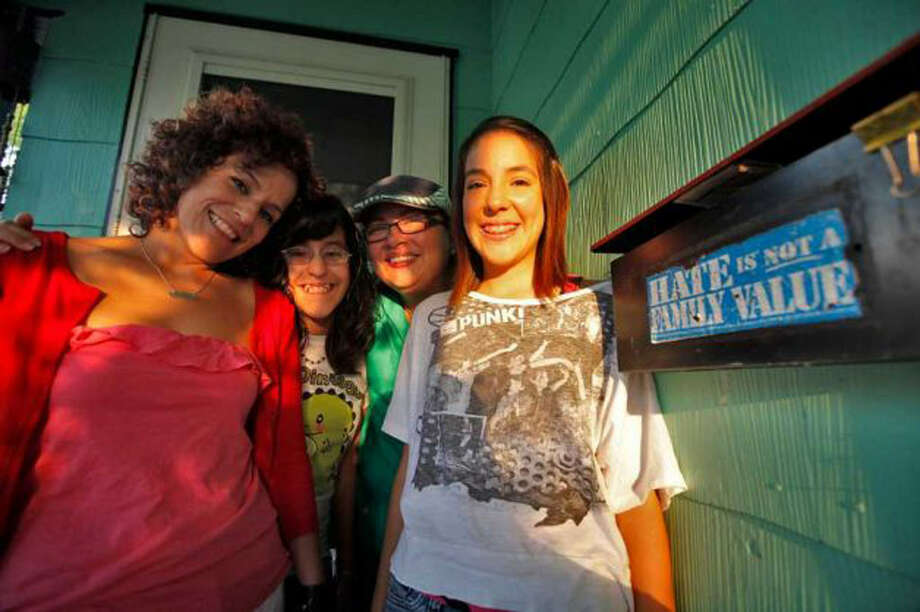 Erika Casasola (left) and Anel Flores (second from right), with daughters Jessica (right) and Klarissa, shown in September 2011, will appear on Katie Couric's daytime talk show Tuesday in support of marriage equality. Photo: San Antonio Express-News File Photo