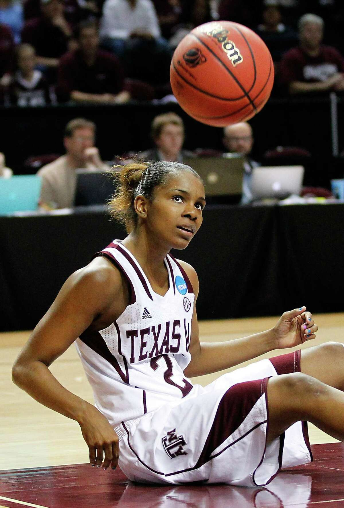 Texas A&M's Cierra Windham pounds the ball in frustration after struggling to call a timeout.