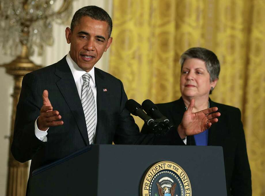 President Barack Obama (L) speaks while Homeland Security Secretary Janet Napolitano listens during a naturalization ceremony in the East Room of the White House on March 25. What are they up to on immigration? Photo: Mark Wilson, Getty Images / 2013 Getty Images