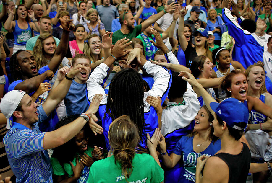 Florida Gulf Coast guard Sherwood Brown is surrounded by fans during a pep rally for the Eagles on the school's campus in Fort Myers, Fla. Photo: William DeShazer, MBR / Naples Daily News