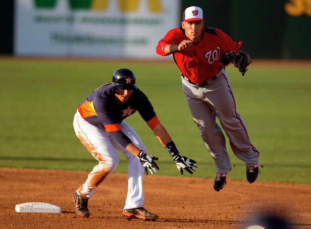 Nationals infielder Ian Desmond turns a double play as Jason Castro of the Astros slides into second base during the second inning. Photo: Evan Vucci