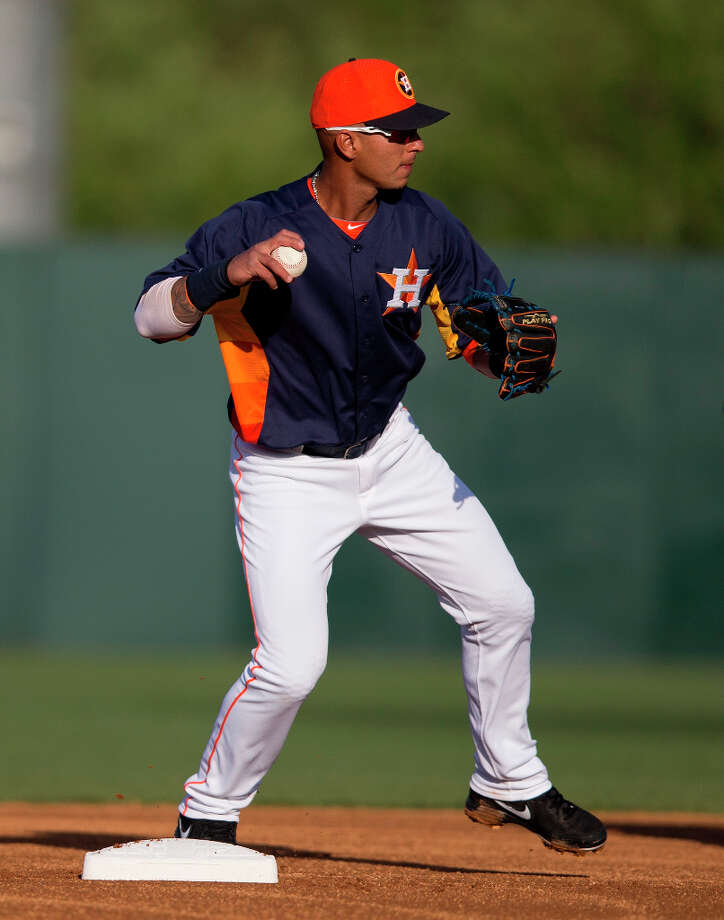 Astros infielder Ronny Cedeno turns a double play during the first inning. Photo: Evan Vucci