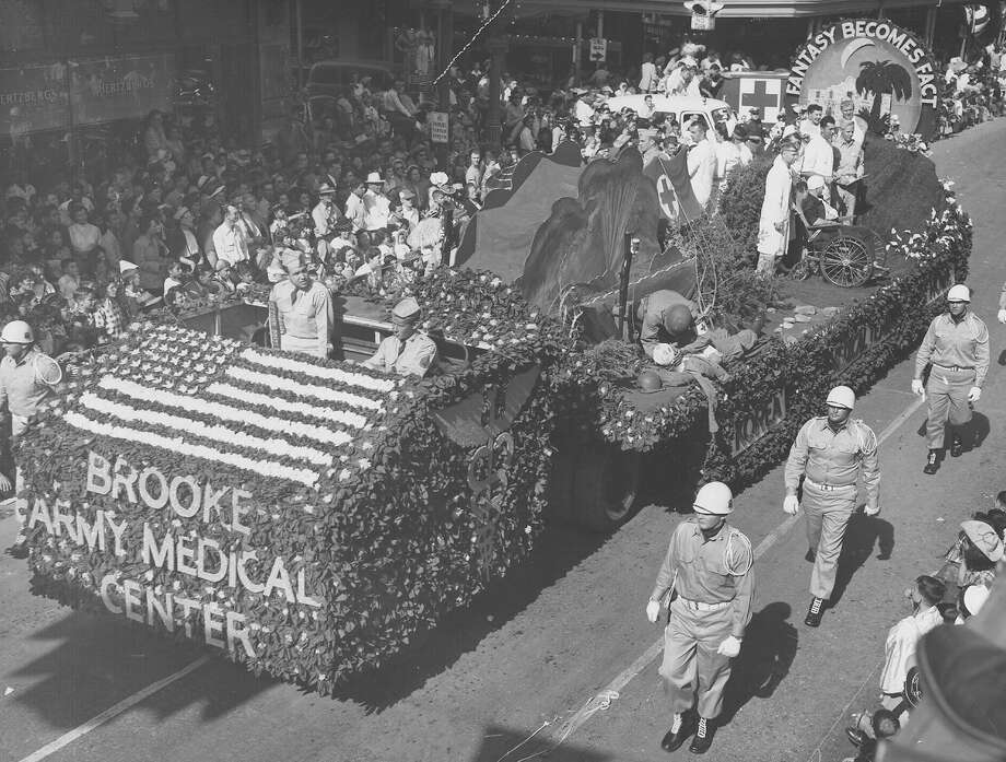 Battle of Flowers 1952: The float entered by Brooke Army Medical Center depicts a man being treated on the field by a Medical Corp soldier and other phases of treatment. Photo: San Antonio Express-News File Photo