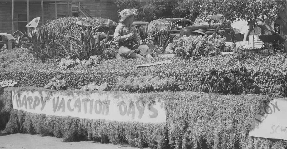 Battle of Flowers 1949:  A barefoot boy fishing in a pond won the hearts of the judges for the first prize in Section E, rural schools. It was entered by Leon Valley School. The float recreates a typical Texas outdoor scene with lily pads, the old fishin' hole and boy with pole. Photo: San Antonio Express-News File Photo