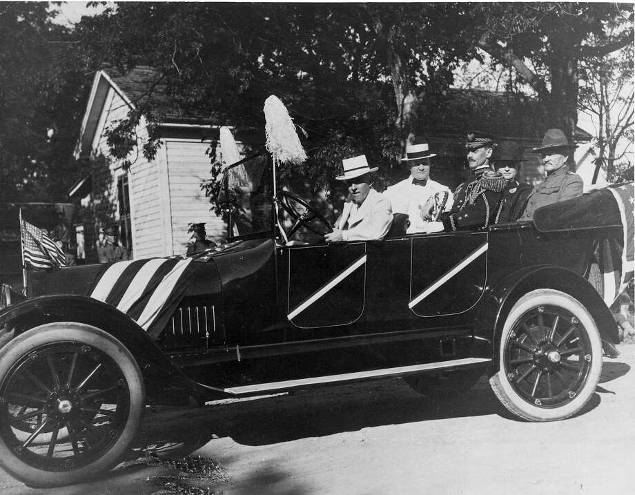 "Battle of Flowers 1917: Gen. ""Black Jack"" Pershing (right) rides with Ayers B.G. Hutchinson and Gov. James E. Ferguson in the parade. Avriel Vanderpoorten is driving the car; the others are not identified. Photo: Courtesy Photo / Fort Sam Houston / FORT SAM HOUSTON"