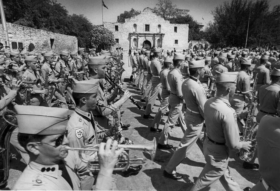 Battle of Flowers 1983: The Fightin' Texas A&M Aggie Band marches in front of the Alamo. Photo: San Antonio Express-News File Photo / SAN ANTONIO EXPRESS-NEWS