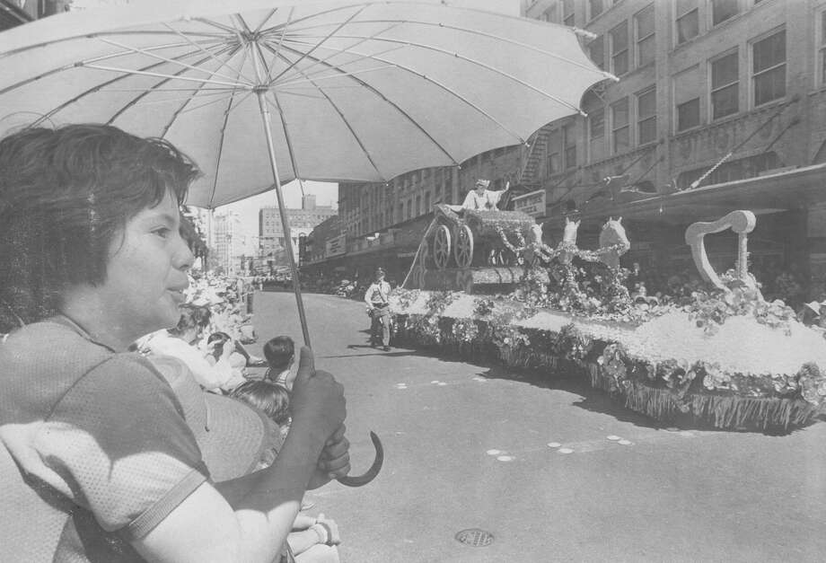 Battle of Flowers 1980: Greg Gonzales, 10, watches as the float carrying Fiesta Queen Mary Elizabeth Pryor passes by. Photo: San Antonio Express-News File Photo