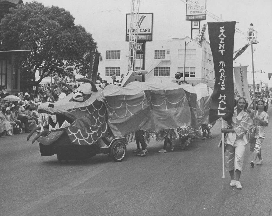 Battle of Flowers 1975: A Chinese dragon is part of the float from Saint Mary's Hall. Photo: San Antonio Express-News File Photo