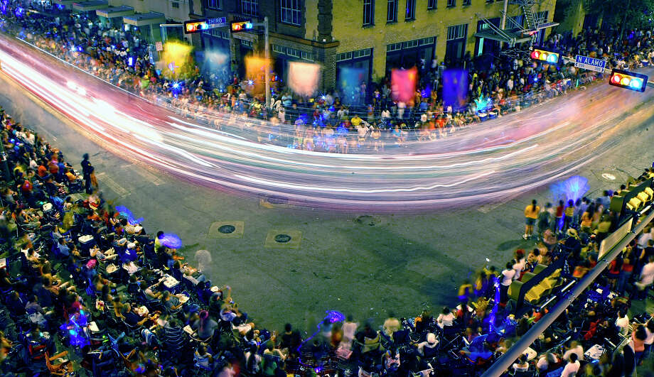 The Fiesta Flambeau Parade began in 1948 and is now billed as America's largest illuminated parade. Here's a look back at memorable scenes captured at Fiesta's night parade over the years.  Compiled by Merrisa Brown, mySA.com.PHOTO: Streaks of light show the path of an illuminated float as it rounds the corner of Alamo and Third streets during the 2009 Fiesta Flambeau Parade. Photo: William Luther / San Antonio Express-News / SAN ANTONIO EXPRESS-NEWS