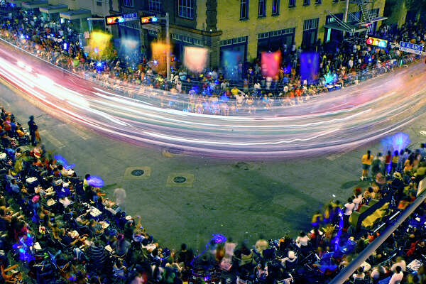 The Fiesta Flambeau Parade began in 1948 and is now billed as America's largest illuminated parade. Here's a look back at memorable scenes captured at Fiesta's night parade over the years.  Compiled by Merrisa Brown, mySA.com.  PHOTO: Streaks of light show the path of an illuminated float as it rounds the corner of Alamo and Third streets during the 2009 Fiesta Flambeau Parade.
