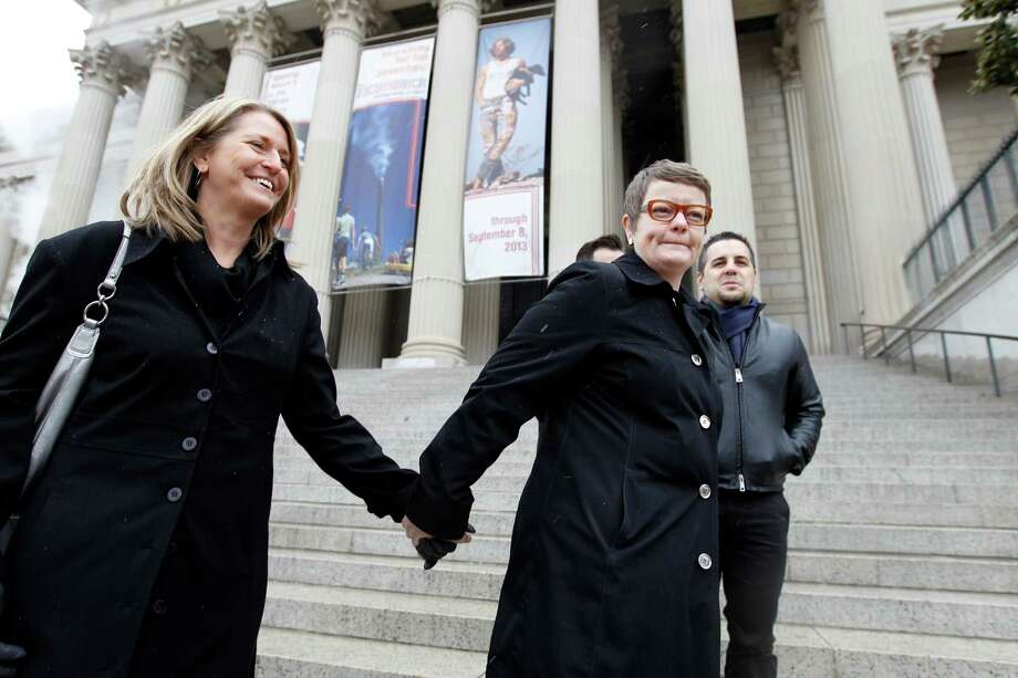 Sandy Stier, left, and Kris Perry of Berkeley, Calif., stand outside the National Archives in Washington, Monday, March 25, 2013, before going inside to view the U.S. Constitution, a day before their same-sex marriage case is argued before the Supreme Court. Photo: Jose Luis Magana