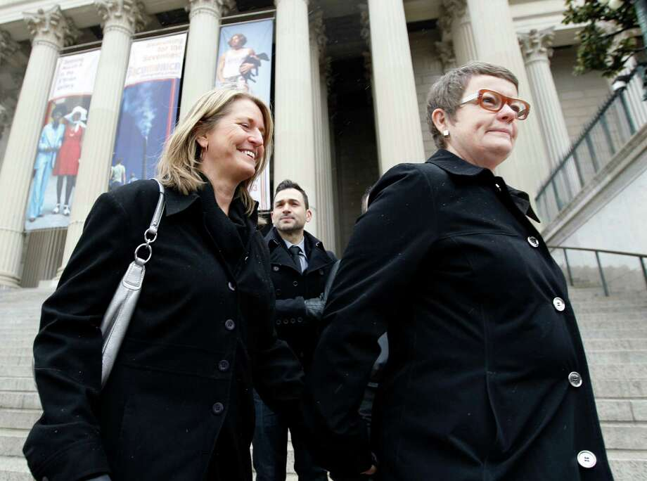 Sandy Stier, left, and Kris Perry stand outside the National Archives in Washington, Monday, March 25, 2013, before going inside to view the U.S. Constitution, a day before their same-sex marriage case will be heard before the Supreme Court. Photo: Jose Luis Magana