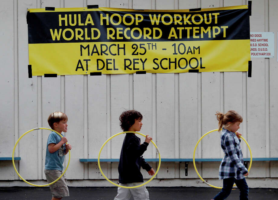 Students walked single file to the playground for their workout. Del Rey Elementary School in Orinda, Calif. assembled about 400 of their students on the playground Monday March 25, 2013 to try to break the Hula Hoop workout record for the Guinness World Records. Photo: Brant Ward, The Chronicle / ONLINE_YES