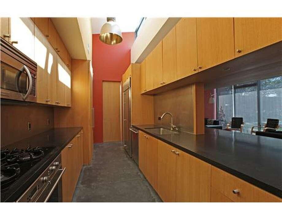Kitchen in the hallway/hallway in the kitchen. All photos via Estately/MLS/Southfields Real Estate, Inc.